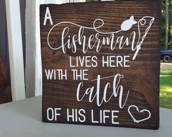 A Fisherman Lives Here With The Catch Of His Life Standing Wood Block Sign
