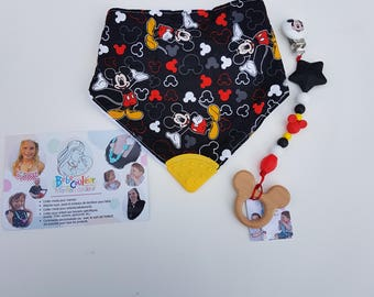 DUO bib and tie pacifier clip with a toy of