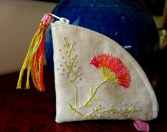 Embroidery on suede clutch bag, tree branches and flower