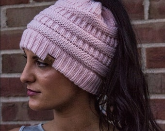Light pink ponytail beanie.