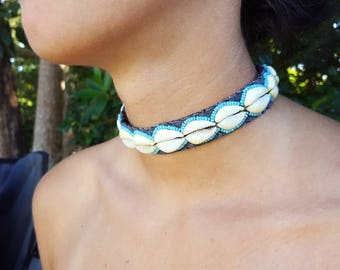 Single Row Cowrie shell necklace.
