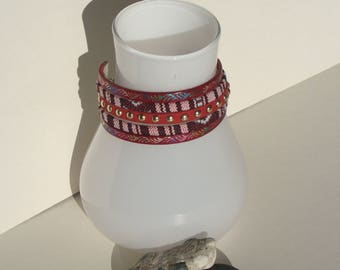 Ethnic bracelet in red leather with weaving and suedine,
