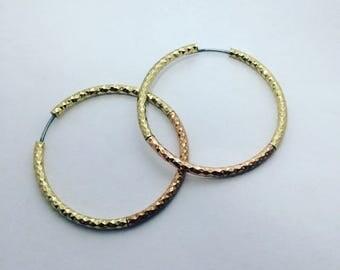 Goldy earrings in three stiles