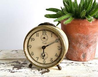 Old alarm clock Cream 'Kienzle'