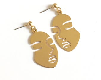 Gold Closed Eyes Face Earrings