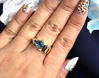 14 Karat Yellow Gold Blue Topaz Diamond Ring
