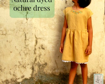 Girl's dress in natural ochre with hand embroidery, lace, khadi cotton, handloom, eco friendly clothing