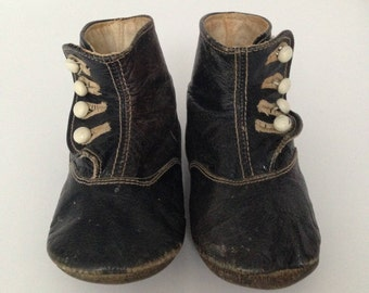 Victorian antique black leather baby shoes .