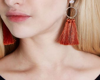 Light triple tassel drop earrings