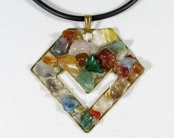 Elegant pendant made of bronze and mosaic of gemstones - quartz, conrelian, citrine, jasper