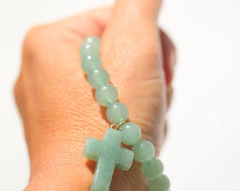 A cool bracelet with Aventurine gemstones and a cross pendant in the same stone