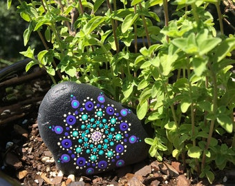 Mandala stone in blues and purples