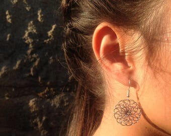 Earrings made with simple, light gray colored copper wire.