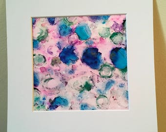 Blossom an abstract alcohol ink painting on Yupo 19.5 x 21 cm in square white mount