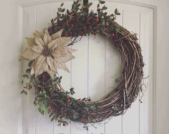 Winter grapevine wreath with berries and burlap poinsettia