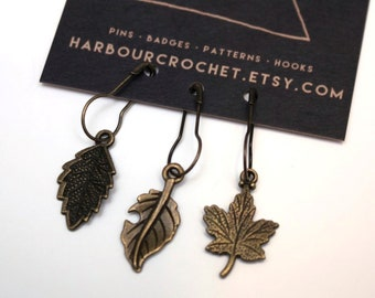 Set of 3 leaf stitch markers; antique brass toned metal on bulb shaped safety pins. Perfect knitter or crochet gift