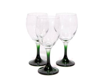 Wine glasses with green stem