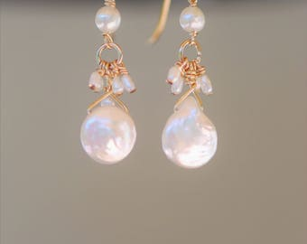 Fresh water pearl drop earrings on 14k solid  gold ear wires