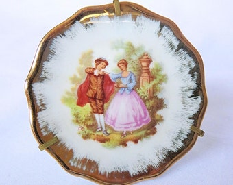 Vintage small porcelain Limoges plate with Fragonard image, includes small standard