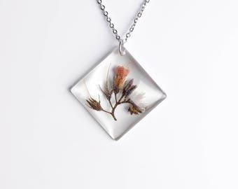 Resin pendant with true flower-blue adder's stem-