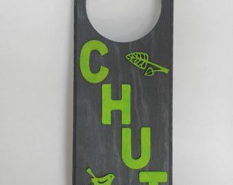 grey and green door handle plate