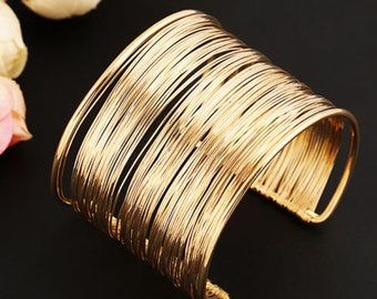 gold and silver women bracelets
