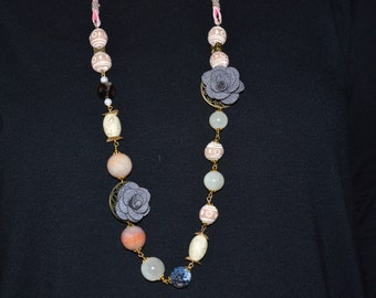long necklace with pearls of different shape and material