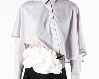 Women shirt with ruffle-form cape as top layer