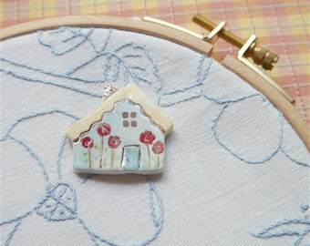 Needleminder, Blue Ceramic English Cottage, Yellow Roof and Red Flowers