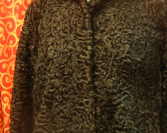 "1950's, 40"" bust, jet black Persian lamb coat."