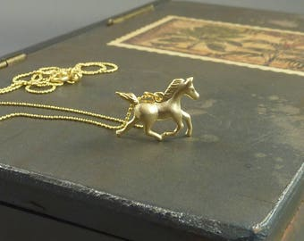 Xander. Gold Horse Necklace. horse jewelry. equestrian jewelry. whimsical jewelry. gold horse. gold necklace. modern necklace.