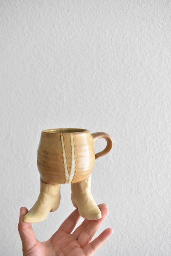 hand thrown foot stoneware coffee mug / beige tan