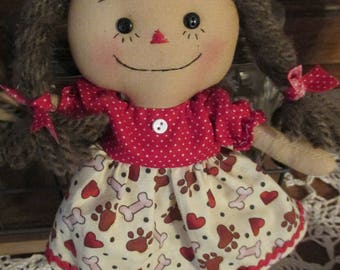 Mini Brown haired raggedy with dog bone and paw print dress