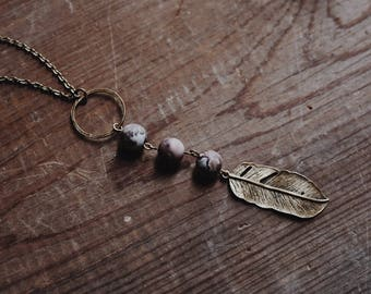 fly free. an earthy bohemian jasper bead + feather charm statement necklace