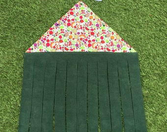 Peekaboo forest curtain for guinea pigs. Fruit pattern polycotton and dark green fleece. 1 metre of white cotton tape included.