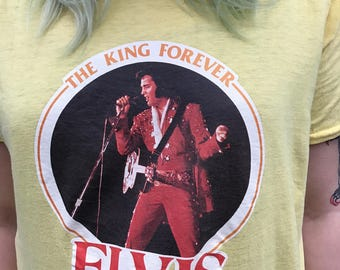 Vintage Elvis The King Forever tee shirt on yellow 1977