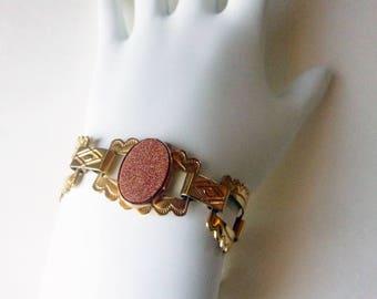 Modern goldstone glass southwest style goldtone link statement bracelet circa 1980s