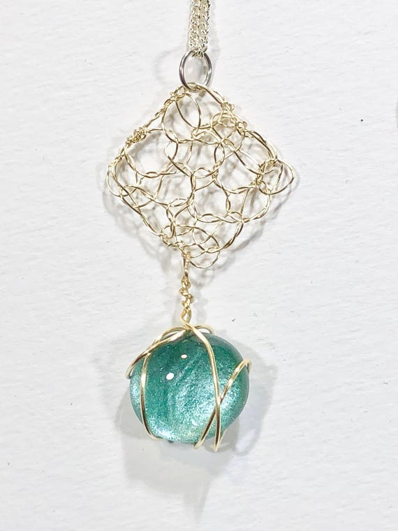 Necklace - silver plated wire crochet diamond shape pendant with turquoise blue round glass cabochon