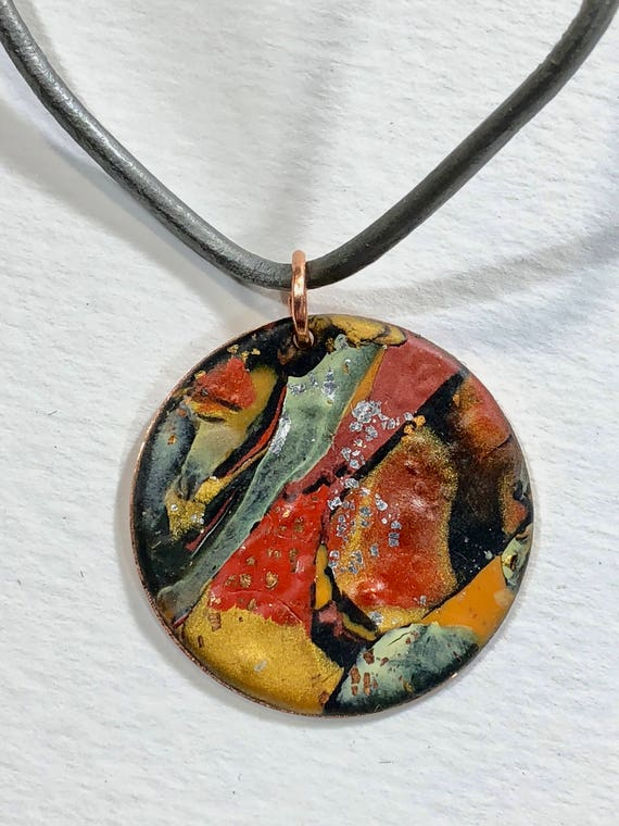Handmade orange/red/yellow/black/gray/silver/copper polymer clay round pendant necklace with abstract asymmetric design
