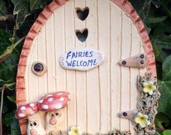 Fairy door, ceramic, garden fairy door, fairies welcome.