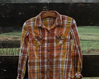 Soft orange flannel with studs (sz: XS)