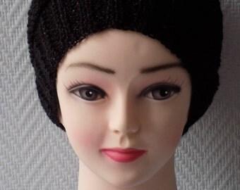 Knit hat, stitch fancy, black, metallic threads.