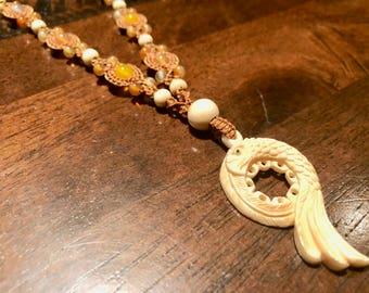 Eagle carved macrame pendant necklace