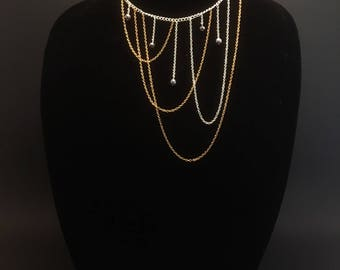 Asymmetrical layered chains in gold and silver
