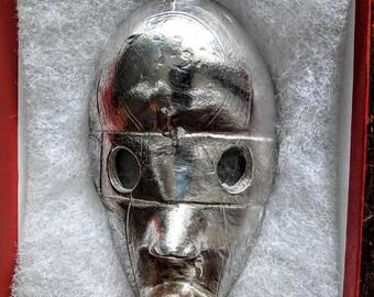 Dan passport mask in solid sterling silver. 1/1