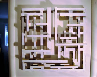 wood and paint chip wall sculpture,titled 3-D Piet