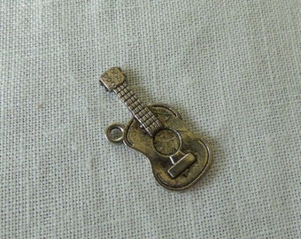 Charms silver colored guitar music instrument
