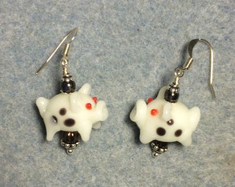 White with brown spots lampwork pig bead earrings adorned with brown Czech glass beads.