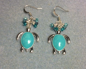 Turquoise enamel turtle charm earrings adorned with small turquoise Czech glass beads.