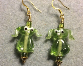Translucent lime green lampwork floppy eared puppy dog bead earrings adorned with lime green Czech glass beads.